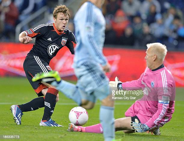 Sporting KC goalkeeper Jimmy Nielsen riht thwarts a shot on goal by DC United's Jared Jeffrey left in the first half on Friday October 18 at Sporting...