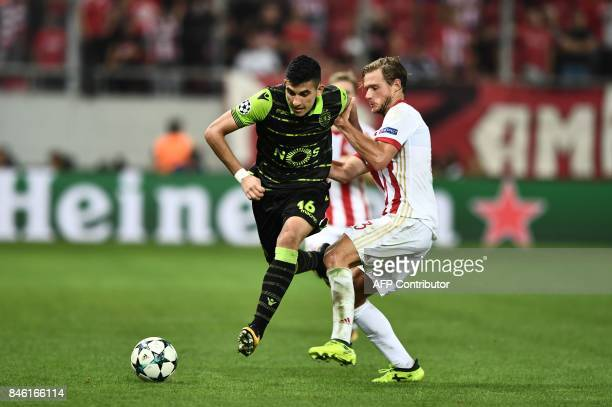 Sporting Lisbon's Argentinian midfielder Rodrigo Battaglia outruns Olympiacos' Belgian defender Guillaume Gillet during the UEFA Champions League...