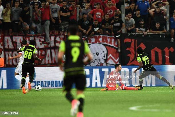 Sporting Lisbon's forward Gelson Martins scores past Olympiacos' goalkeeper Stefanos Kapino during the UEFA Champions League Group D football match...