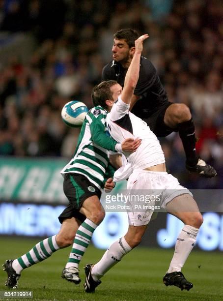 Sporting Lisbon's Pedro Rui Patricio collides with Bolton Wanderers' Heidar Helguson