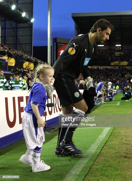 Sporting Lisbon's Pedro Rui Patricio makes his way out on to the pitch with a mascot prior to kick off