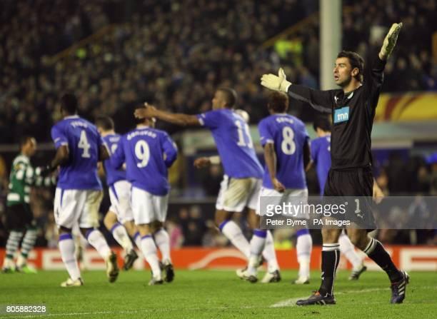 Sporting Lisbon's Pedro Rui Patricio protests after Everton's Sylvain Distin scored his team's second goal
