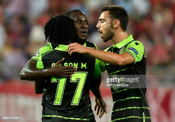 Sporting Lisbon's players celebrate their second goal during the Group D UEFA Champions League football match between Olympiacos and Sporting Lisbon...