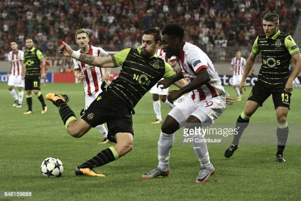 Sporting Lisbon's Uruguayan defender Sebastian Coates fights for the ball with Olympiacos' Nigerian Defender Emmanuel Emenike during the Group D UEFA...