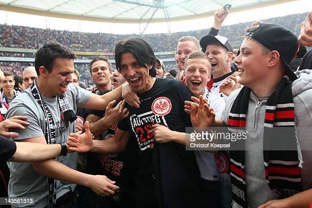 Sporting manager Bruno Huebner of Frankfurt and fans celebrate the ascent to the 1 Bundesliga aft the Second Bundesliga match between Eintracht...