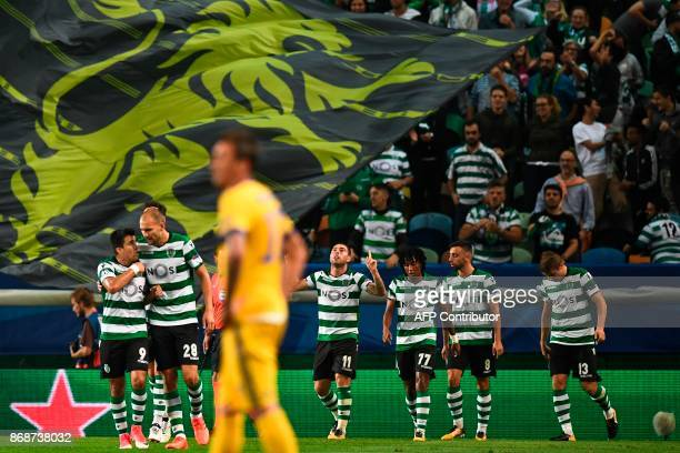 Sporting players celebrate after Sporting's Brazilian midfielder Bruno Cesar scored against Juventus FC during the Champions League Group D football...