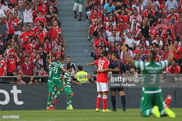 Sporting players celebrating Sporting's goal during the Primeira Liga match between SL Benfica and Sporting CP at Estadio da Luz on August 31 2014 in...