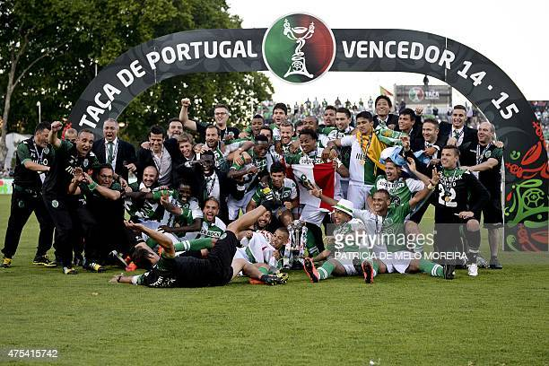 Sporting players pose for a photo with the trophy at the end of the Taca de Portugal football match final Sporting CP vs SC Braga at Jamor stadium in...