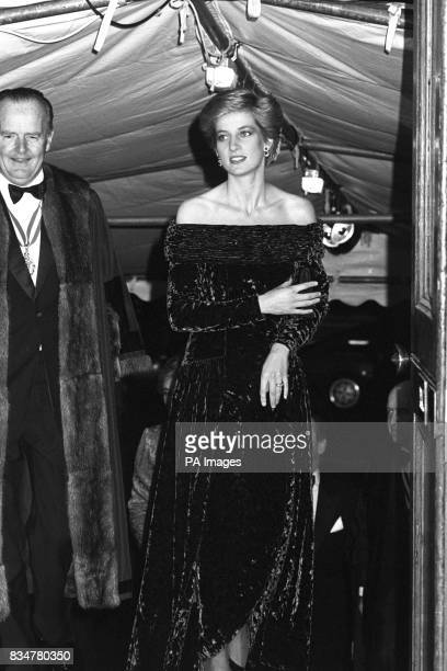 Sporting silver body glitter on her bare shoulders the Princess of Wales arrives at Fishmongers Hall London tonight when she was guest of honour at...