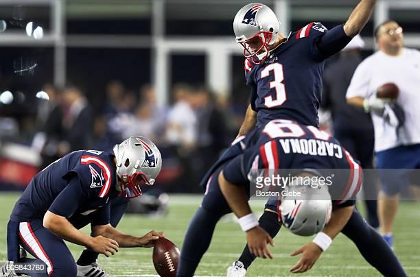 Sporting the special Thursday Night uniforms New England Patriots place kicker Steven Gostkowski holder Ryan Allen and long snapper Joe Cardona...