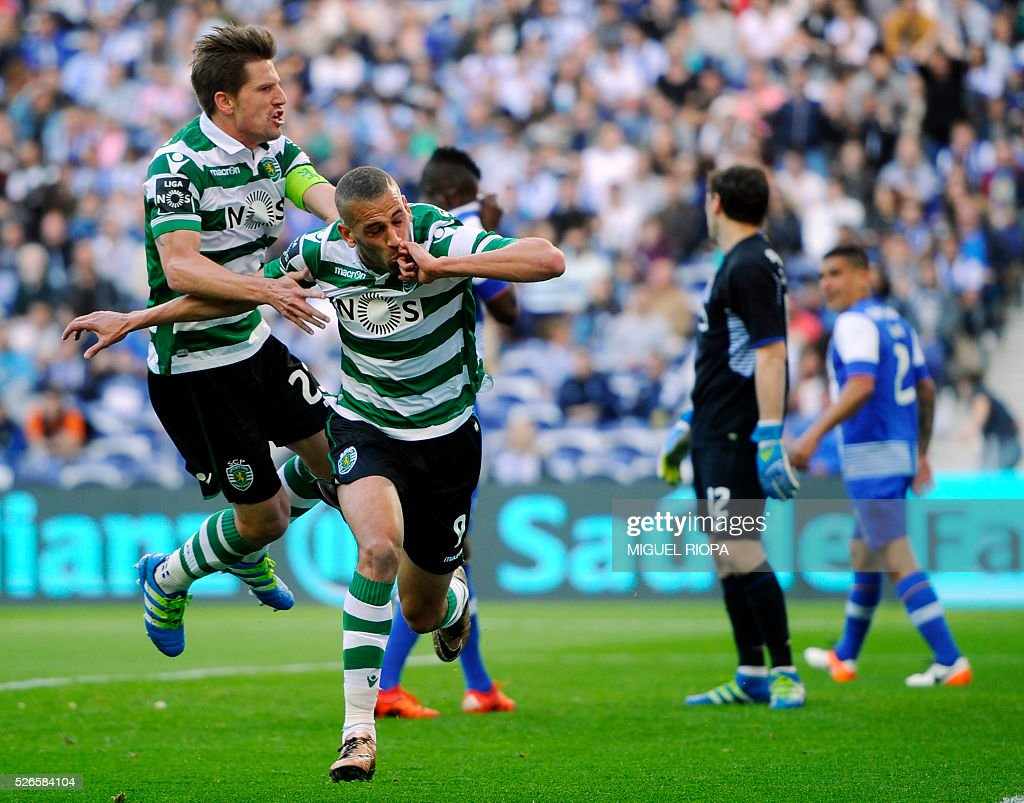 Sporting's Algerian forward Islam Slimani (2nd L) celebrates a goal with teammate midfielder Adrien Silva (L) during the Portuguese league football match FC Porto vs Sporting CP at the Dragao stadium in Porto on April 30, 2016. / AFP / MIGUEL