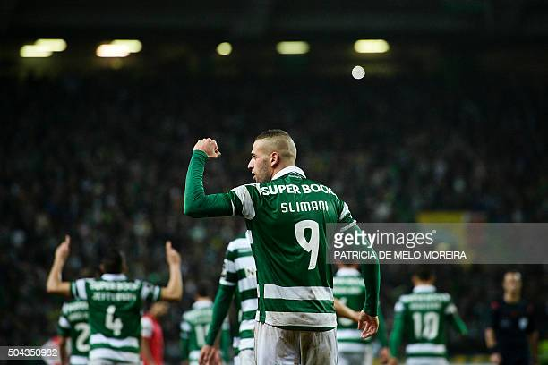 Sporting's Algerian forward Islam Slimani celebrates after scoring during the Portuguese league football match Sporting CP vs SC Braga at the Jose...