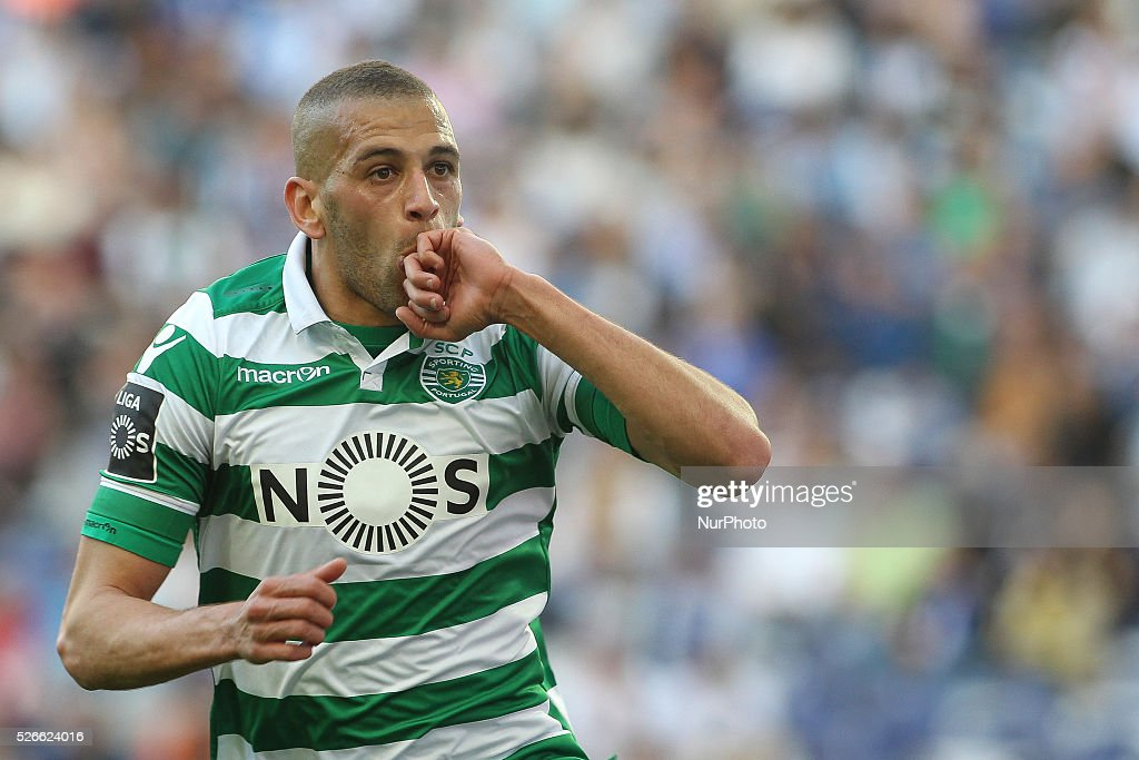 Sporting's Algerian forward <a gi-track='captionPersonalityLinkClicked' href=/galleries/search?phrase=Islam+Slimani&family=editorial&specificpeople=9704639 ng-click='$event.stopPropagation()'>Islam Slimani</a> celebrates after scoring goal during the Premier League 2015/16 match between FC Porto and Sporting CP, at Drag��o Stadium in Porto on April 30, 2016.