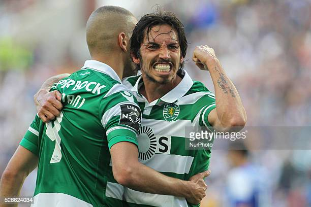 Sporting's Algerian forward Islam Slimani celebrates after scoring goal with teammate Schelotto during the Premier League 2015/16 match between FC...
