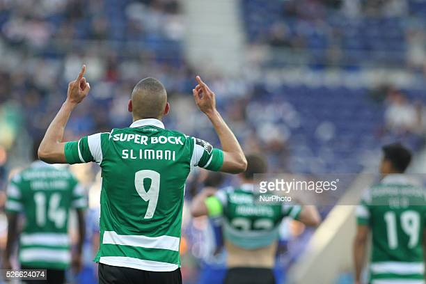 Sporting's Algerian forward Islam Slimani celebrates after scoring goal during the Premier League 2015/16 match between FC Porto and Sporting CP at...