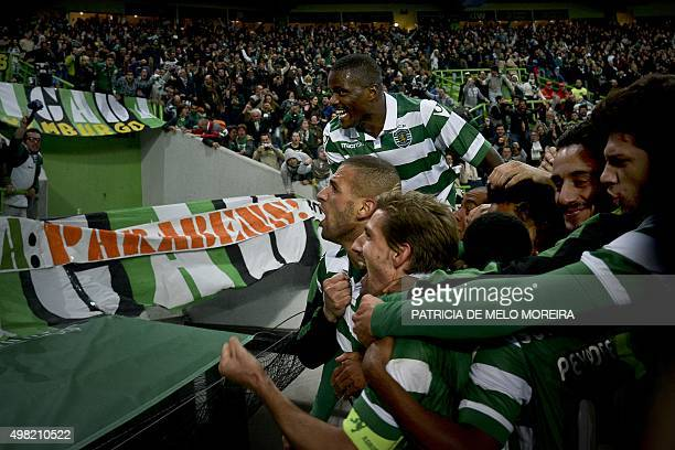 Sporting's Algerian forward Islam Slimani celebrates with his teammates after scoring against SL Benfica during the extra time of the Portuguese Cup...