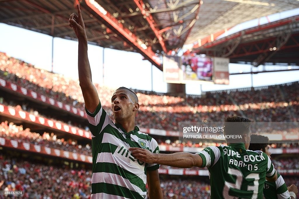 Sporting's Algerian forward Islam Slimani celebrates with teammates after scoring a goal against Benfica during their Portuguese Liga football match at the Luz stadium in Lisbon on August 31, 2014.