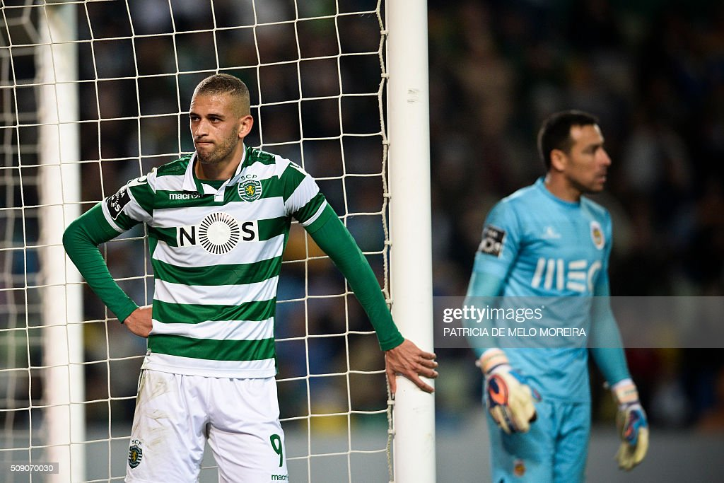 Sporting's Algerian forward Islam Slimani (L) looks on during the Portuguese league football match Sporting vs Rio Ave at Alvalade stadium in Lisbon on February 8, 2016. / AFP / PATRICIA DE MELO MOREIRA