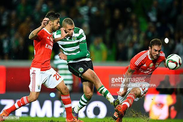 Sporting's Algerian forward Islam Slimani vies with Benfica's defender Silvio Pereira and Benfica's Brazilian defender Jardel Vieira during the...