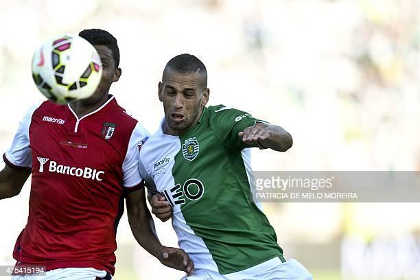 Sporting's Algerian forward Islam Slimani vies with Braga's Brazilian defender Aderlan Santos during the Taca de Portugal football match final...