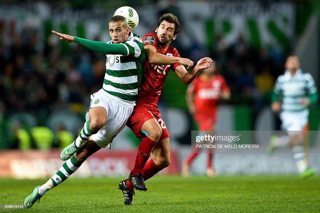 Sporting's Algerian forward Islam Slimani (L) vies with Rio Ave's defender Pedrinho Rocha during the Portuguese Primeira Liga football match between Sporting and Rio Ave at Alvalade stadium in Lisbon on February 8, 2016. / AFP / PATRICIA DE MELO MOREIRA