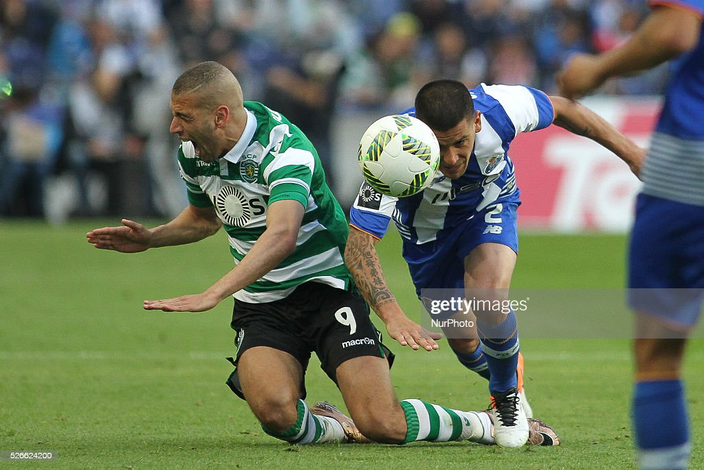 Sporting's Algerian forward <a gi-track='captionPersonalityLinkClicked' href=/galleries/search?phrase=Islam+Slimani&family=editorial&specificpeople=9704639 ng-click='$event.stopPropagation()'>Islam Slimani</a> with Porto's Uruguayan defender <a gi-track='captionPersonalityLinkClicked' href=/galleries/search?phrase=Maxi+Pereira&family=editorial&specificpeople=4500885 ng-click='$event.stopPropagation()'>Maxi Pereira</a> in action during the Premier League 2015/16 match between FC Porto and Sporting CP, at Drag��o Stadium in Porto on April 30, 2016.