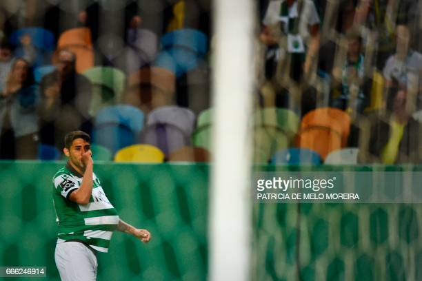 Sporting's Argentine midfielder Alan Ruiz celebrates after scoring during the Portuguese league football match Sporting CP vs Boavista FC at the Jose...