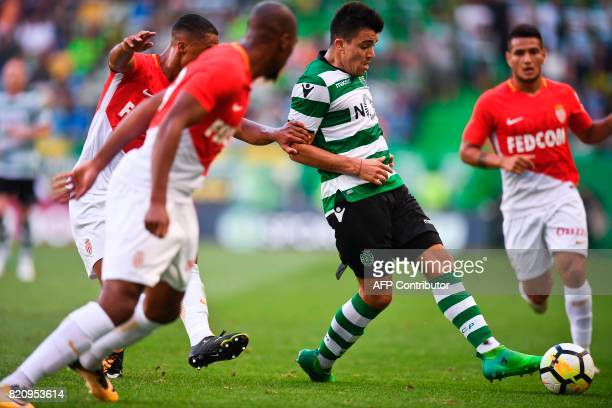 Sporting's Argentine midfielder Marcos Acuna vies with Monaco's Belgian midfielder Youri Tielemans during the friendly match Sporting CP vs AS Monaco...