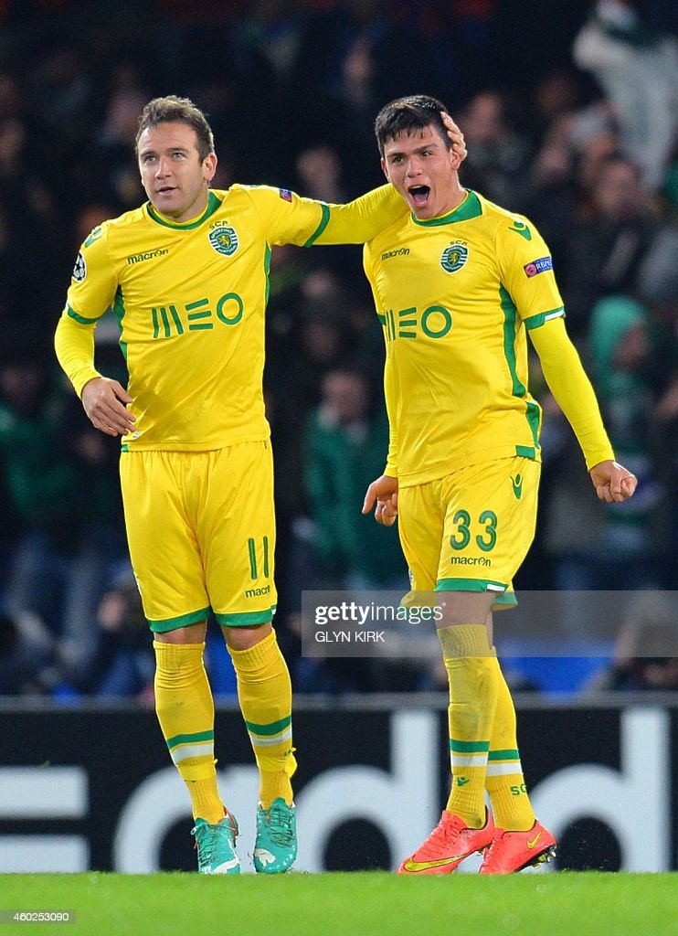Sporting's Argentinian defender Jonathan Silva (R) celebrates scoring his team's first goal with Sporting's Spanish forward <a gi-track='captionPersonalityLinkClicked' href=/galleries/search?phrase=Diego+Capel&family=editorial&specificpeople=4164836 ng-click='$event.stopPropagation()'>Diego Capel</a> during the UEFA Champions League group G football match at Stamford Bridge in London on December 10, 2014.