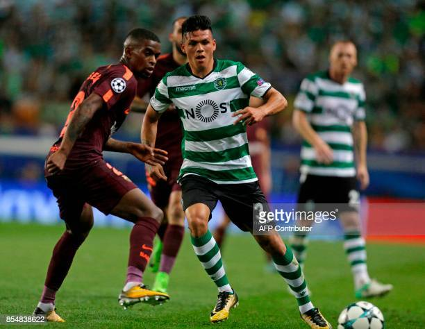 Sporting's Argentinian defender Jonathan Silva vies with Barcelona's Portuguese defender Nelson Semedo during the UEFA Champions League Group D...
