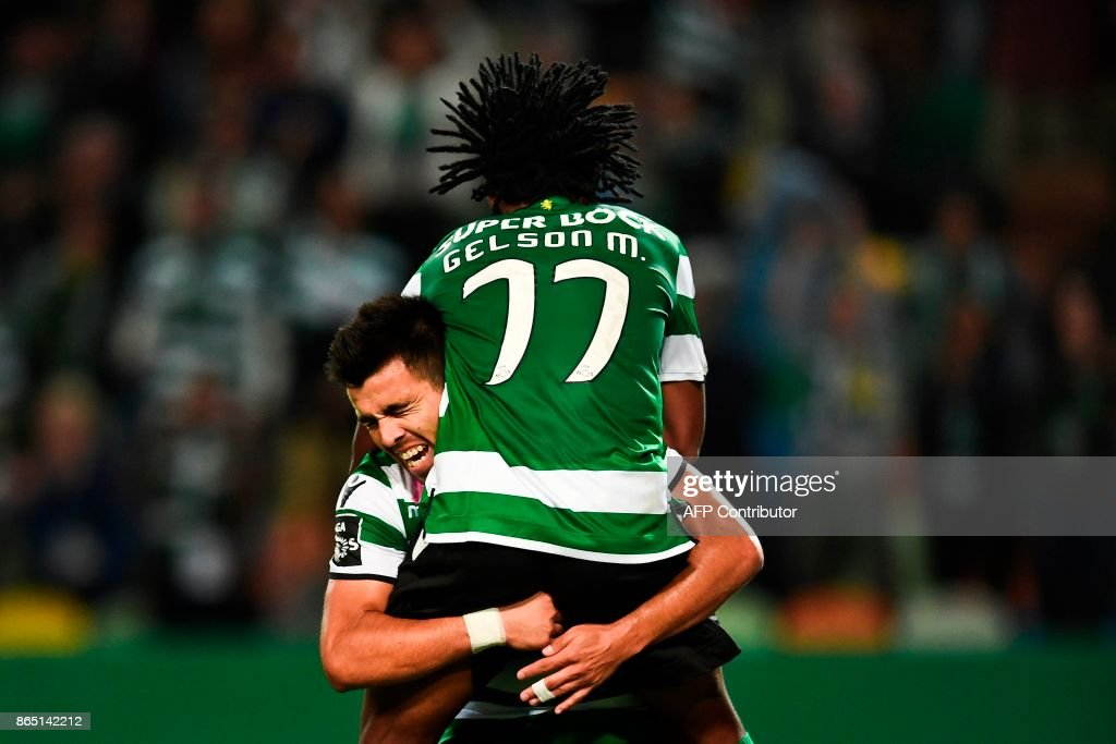 Sporting's Argentinian forward Marcos Acuna (back) celebrates with his teammate Sporting's forward Gelson Martins after scoring a goal during the Portuguese league football match Sporting CP vs GD Chaves at the Jose Alvalade stadium in Lisbon on October 22, 2017. /
