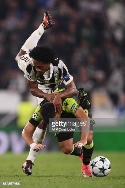 Sporting's Argentinian forward Marcos Acuna fights for the ball with Juventus' forward from Colombia Juan Cuadrado during the UEFA Champions League...