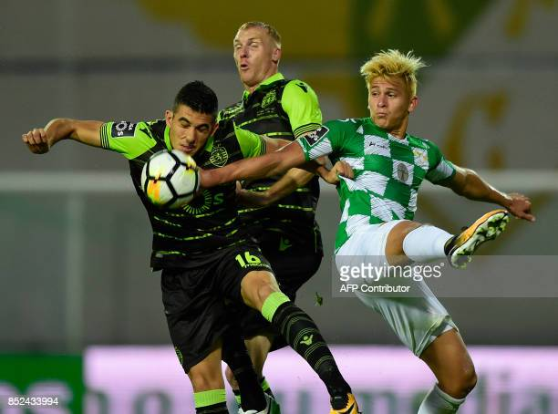 Sporting's Argentinian forward Rodrigo Battaglia jumps for the ball with teammate French defender Jeremy Mathieu and Moreirense's Venezuelan forward...