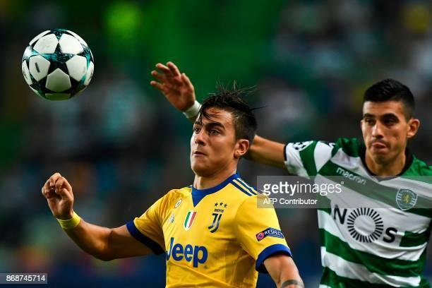 Sporting's Argentinian midfielder Rodrigo Battaglia vies with Juventus' Argentinian forward Paulo Dybala during the Champions League Group D football...