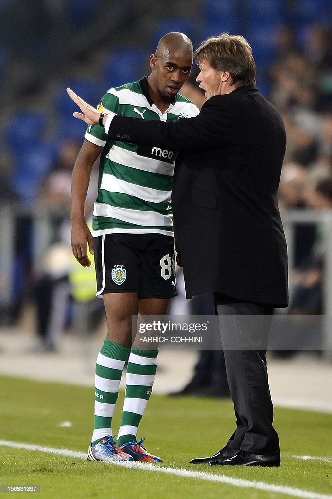 Sporting's Belgian head coach Frank Vercauteren (R) speaks with Sporting's Swiss midfielder Gelson Fernandes during the Europa League UEFA Group G football match between FC Basel and Sporting Clube de Portugal on November 22, 2012, in Basel.