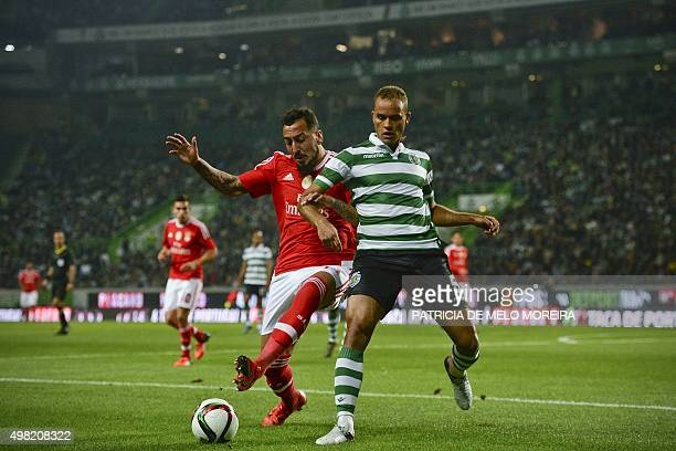 Sporting's Brazilian defender Ewerton vies with Benfica's Greek forward Konstantinos Mitroglou during the Portuguese Cup football match Sporting CP...