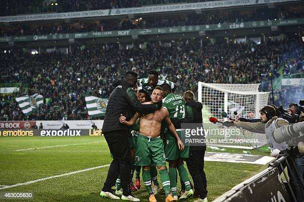 Sporting's Brazilian defender Jefferson Nascimento celebrates with his teammates after scoring during the Portuguese league football match Sporting...