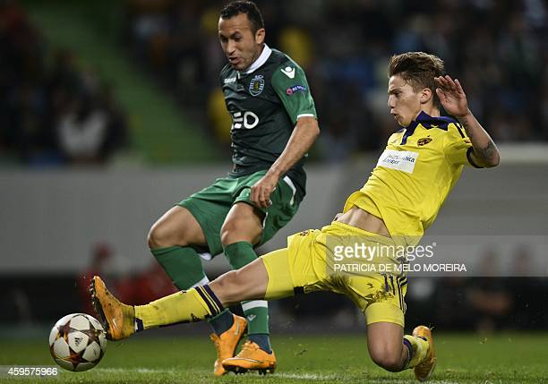 Sporting's Brazilian defender Jefferson Nascimento vies with Maribor's forward Luka Zahovic during the UEFA Champions League football match Sporting...