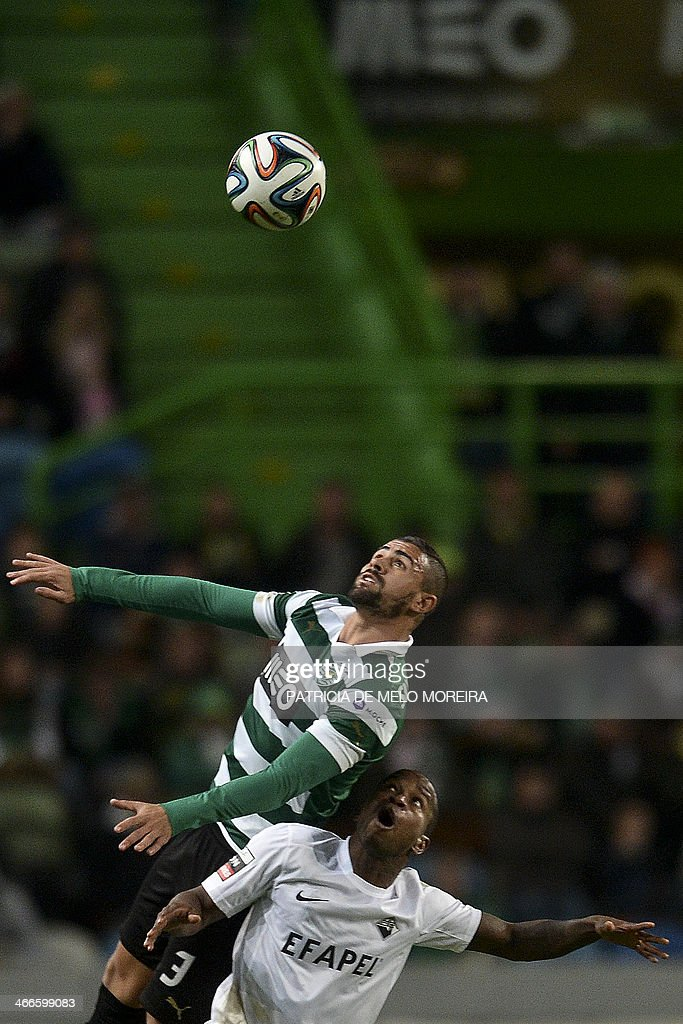 Sporting's Brazilian defender Mauricio (Up) heads the ball past Academica's Brazilian midfielder Makelele during the Portuguese league football match Sporting vs Academica at the Alvalade stadium on February 2, 2014.