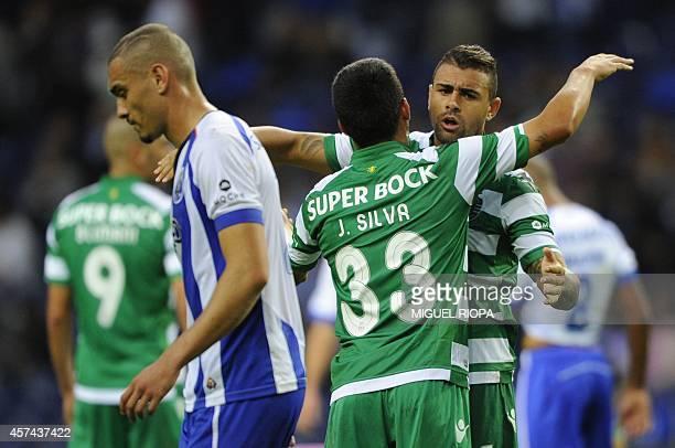 Sporting's Brazilian defender Mauricio Nascimento and Argentinian defender Jonathan Silva celebrate next Porto's Brazilian defender Maicon at the end...