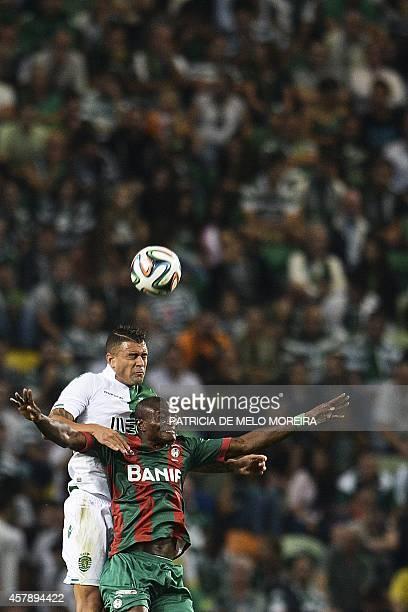 Sporting's Brazilian defender Mauricio Nascimento vies with Maritimo's Nigerian forward Ouwo Maazou during the Portuguese league football match...
