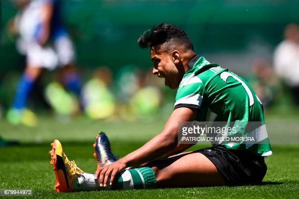 Sporting's Brazilian forward Matheus Pereira sits on the field after missing a goal opportunity during the Portuguese league football match Sporting...