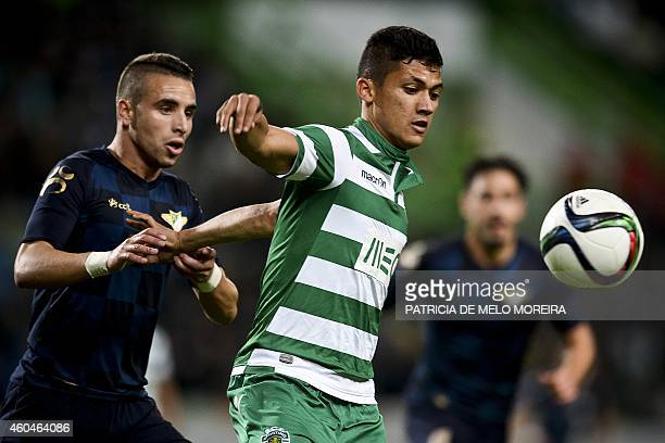 Sporting's Colombian forward Freddy Montero vies with Moreirense's defender Paulo 'Paulinho' Mota during the Portuguese Liga football match Sporting...