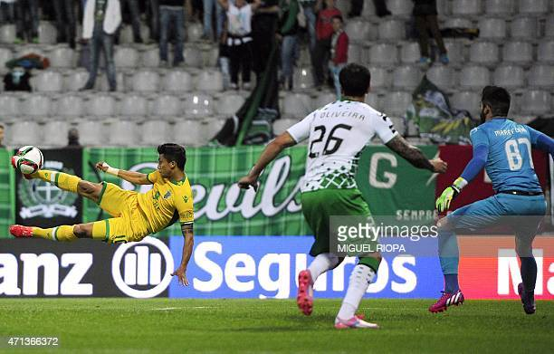 Sporting's Colombian forward Fredy Montero kicks the ball to score a goal during the Portuguese league football match Moreirense FC vs Sporting CP at...