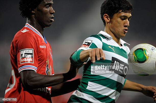 Sporting's Colombian forward Fredy Montero vies with Gil Vicente's Cape Verdean defender Pecks during the Portuguese league football match Gil...