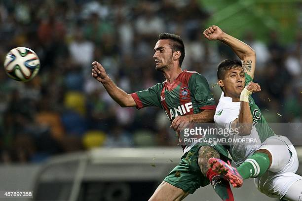 Sporting's Columbian forward Freddy Montero kicks the ball to score against Maritimo during the Portuguese league football match Sporting CP vs...