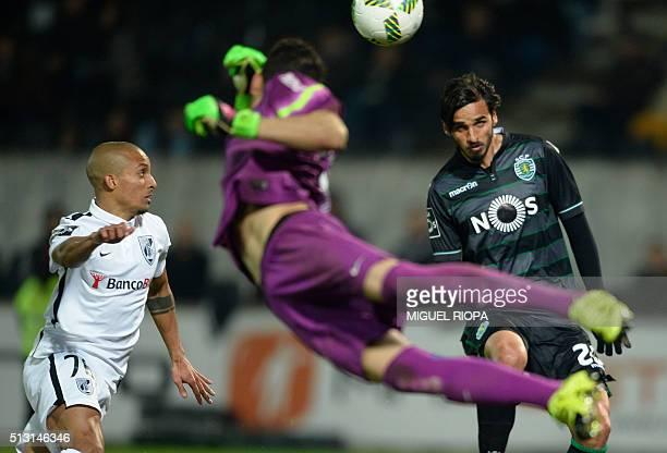 Sporting's Costa Rican forward Bryan Ruiz misses an attempt on goal beside Vitoria Guimaraes' defender Bruno Gaspar during the Portuguese league...