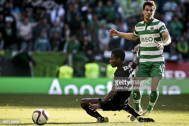 Sporting's defender Cedric Soares vies with Academica's Ghanaian defender Richard Ofori during the Portuguese league football match Sporting vs...