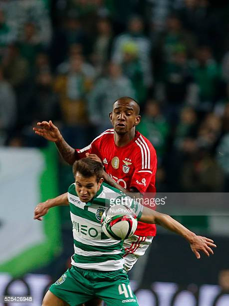 Sporting's defender Cedric vies for the ball with Benfica's midfielder Anderson Talisca during the Portuguese League football match between Sporting...