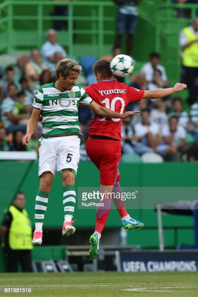 Sporting's defender Fabio Coentrao from Portugal heads the ball with Steaua's forward Florin Tanase during the UEFA Champions League playoffs first...